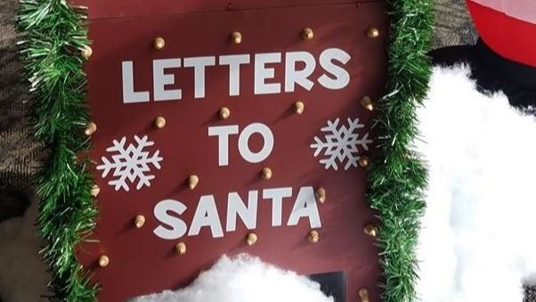 Red mailbox that says Letters to Santa