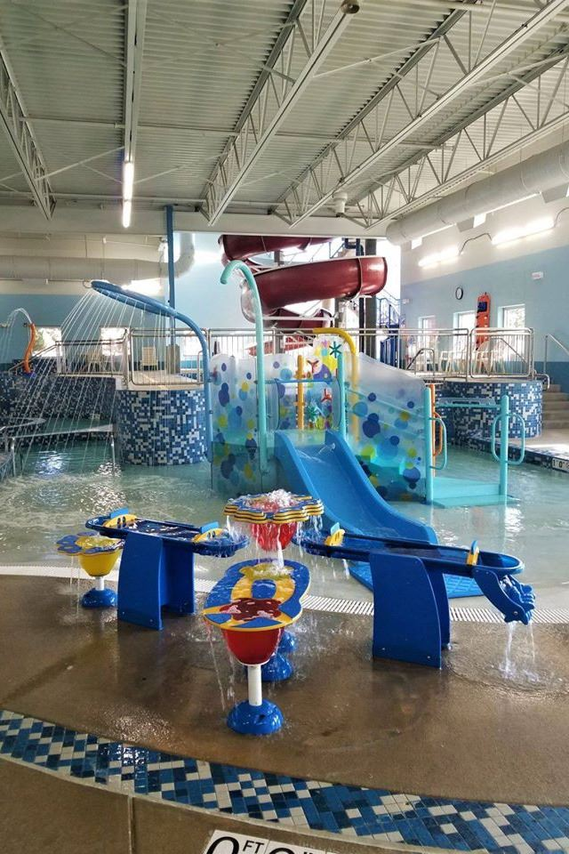 Activity Feature in pool with slide and water play features and fountains